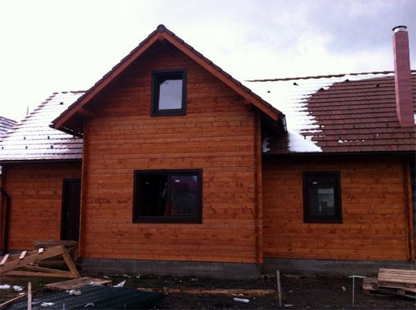 Casa de locuit ecologica construita din grinzi chertate - Poza 3
