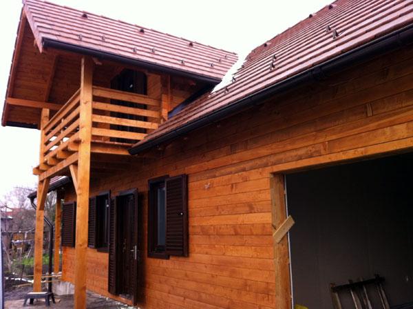Casa de locuit ecologica construita din grinzi chertate - Poza 4