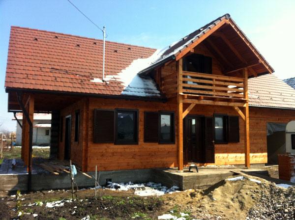 Casa de locuit ecologica construita din grinzi chertate - Poza 9